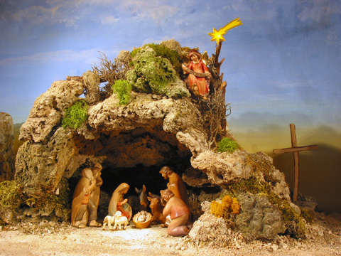 The message of the child nativity scenes cave nativity for Nacimiento belen